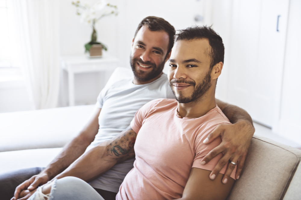 couple on couch looking at camera