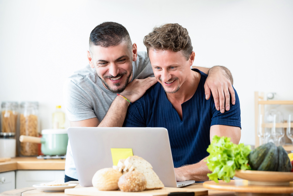 couple reading information about nowprep on laptop